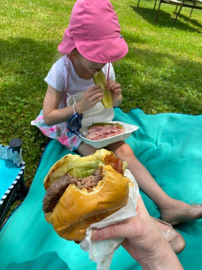 Erin's Daughter Eating Pickle Hoagie